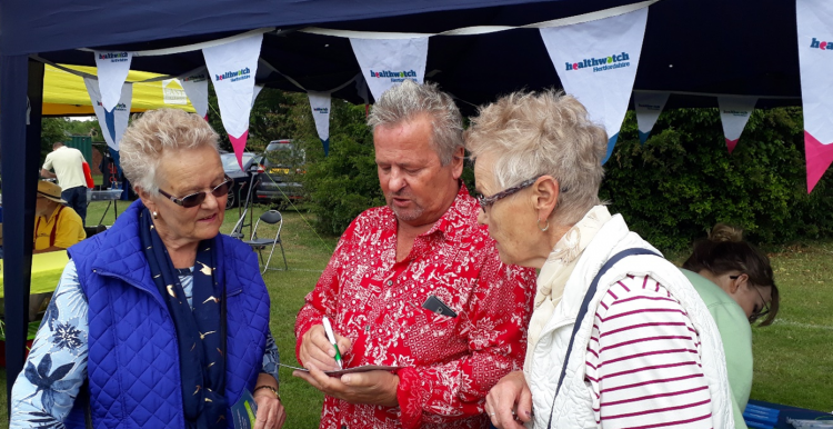 Keith Shephard talking to two members of the public at an event