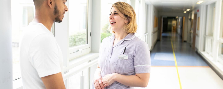Nurse talking to a patient