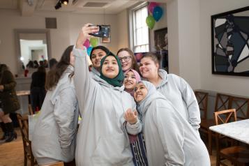 Group of young volunteers having a selfie