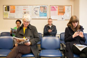 Patients sitting in a GP waiting area