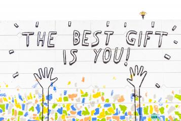 graffiti wall that says the best gift if you