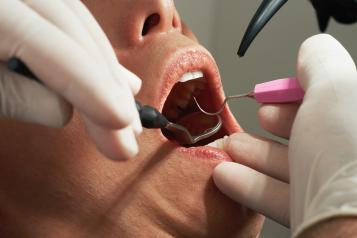 Patient receiving dental treatment