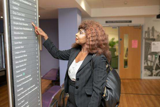 Image of woman visiting hospital looking for directions