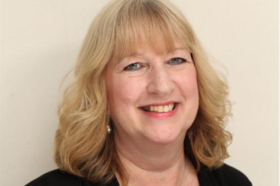 Image of Jane Brown smiling to camera