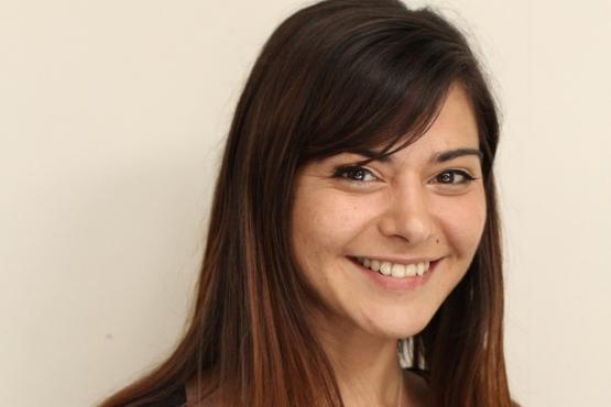 Image of Nuray Ercan smiling to camera