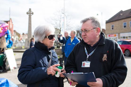 Image of volunteer speaking to a member of the public
