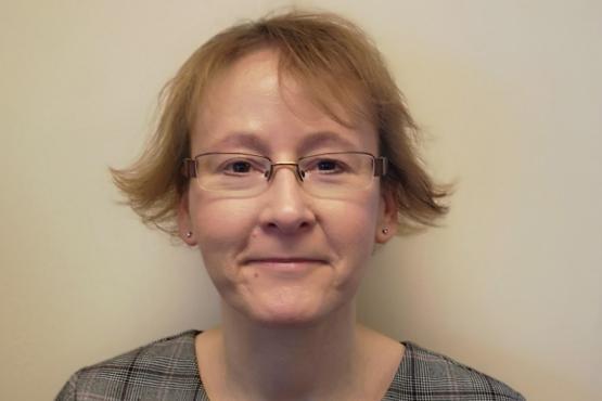 Image of Susan Lee smiling to camera
