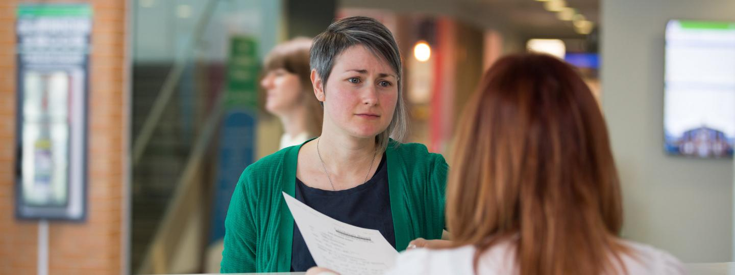 Woman at reception trying to complain