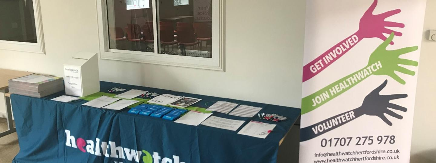 Healthwatch Hertfordshire table set for volunteers event