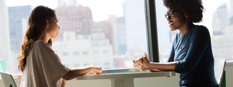 Two women sitting having a conversation