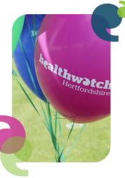 Healthwatch Hertfordshire written on a pink balloon