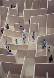 People walking through a maze